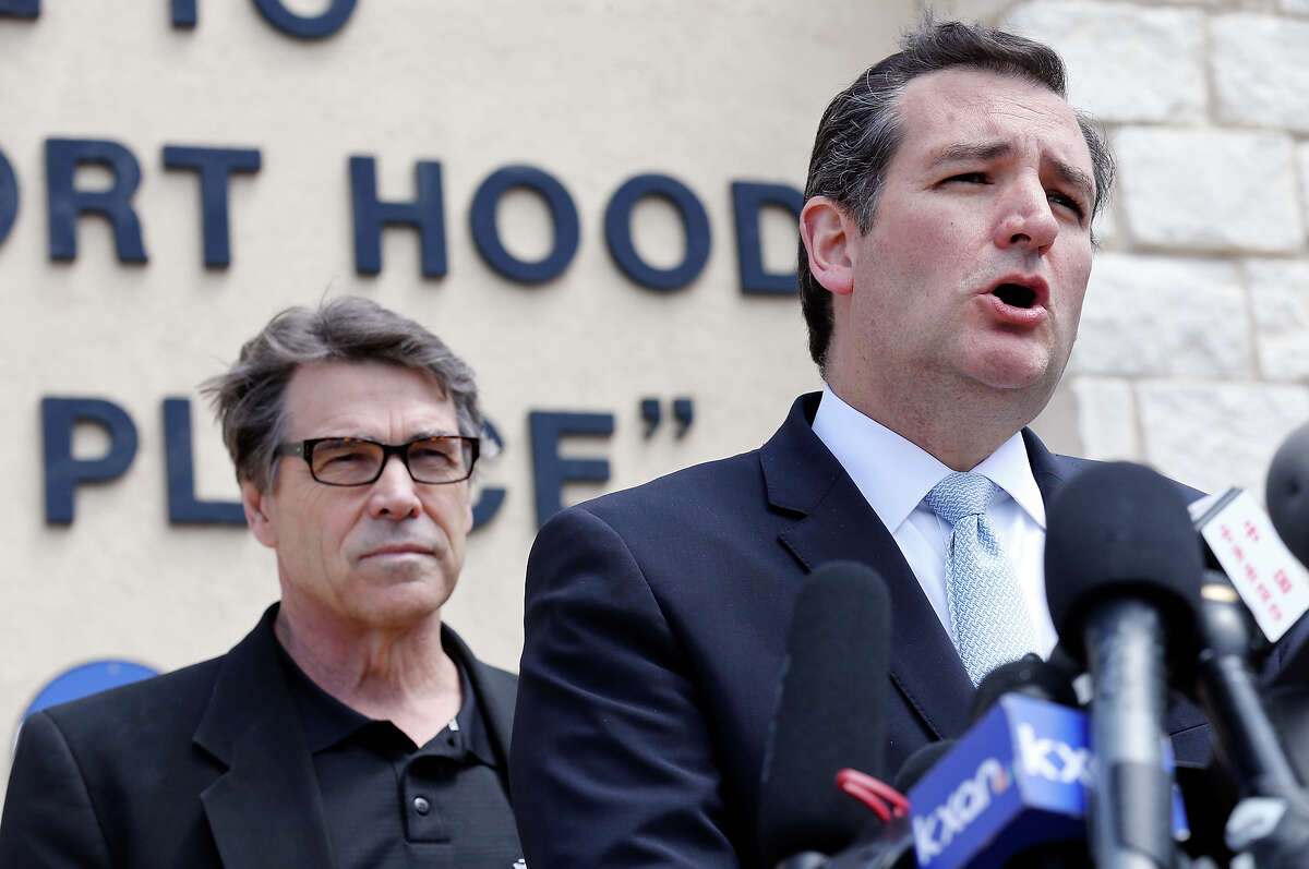 U.S. Sen. Ted Cruz (right) speaks as Gov. Rick Perry and other local officials listen during a press conference held at Fort Hood's main gate Friday April 4, 2014 in Fort Hood, Texas. Iraq war veteran Ivan Lopez opened fire Wednesday afternoon, killing three soldiers and wounding 16 before killing himself as he was confronted by a military policewoman.