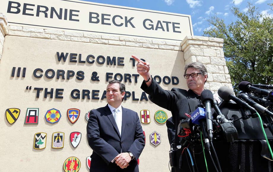 Gov. Rick Perry (right) speaks as U.S. Sen. Ted Cruz and other local officials listen during a press conference held at Fort Hood's main gate Friday April 4, 2014 in Fort Hood, Texas. Iraq war veteran Ivan Lopez opened fire Wednesday afternoon, killing three soldiers and wounding 16 before killing himself as he was confronted by a military policewoman. Photo: Edward A. Ornelas, San Antonio Express-News / ©2014 San Antonio Express-News