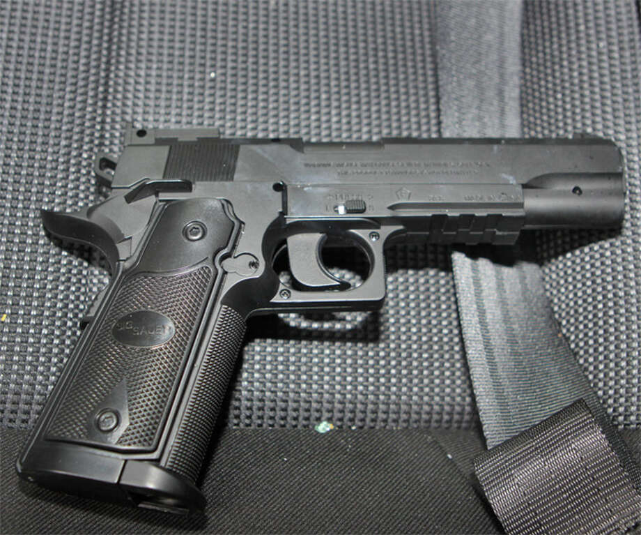Police recovered this Airsoft gun from the vehicle the robber drove. The robber brandished the gun at the Wells Fargo Bank he held up and threatened to kill anyone who called the cops. Photo: Seattle Police Department