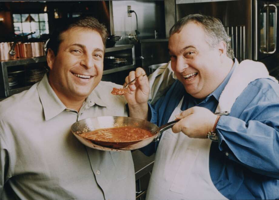 Carrabba's founders Johnny Carrabba, left, and his uncle Damian Mandola are shown in 2002. Photo: Chronicle File