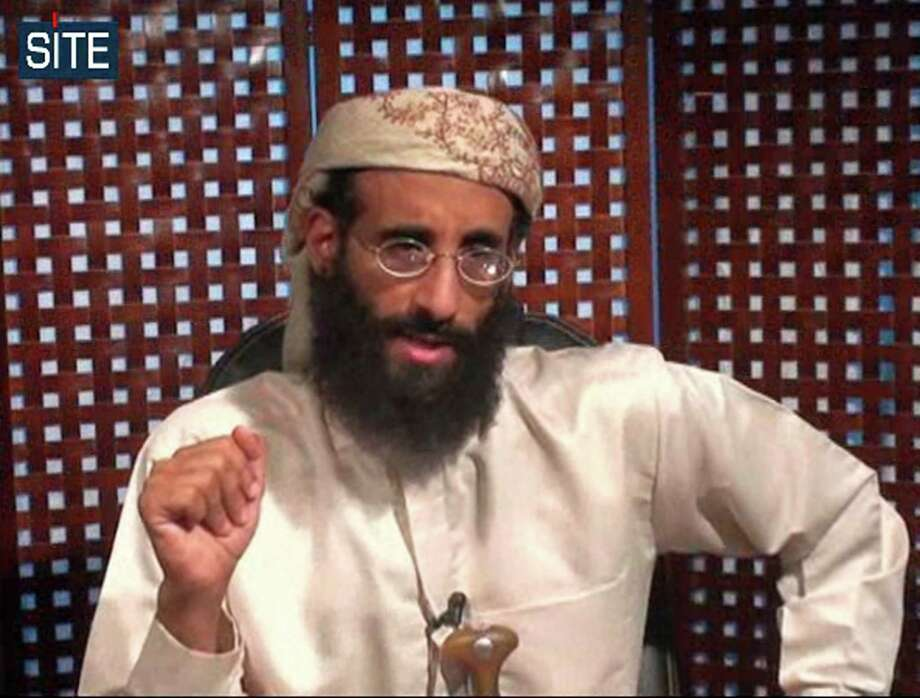 """FILE - In this image taken from video and released by SITE Intelligence Group on Monday, Nov. 8, 2010, Anwar al-Awlaki speaks in a video message posted on radical websites. On Friday, April 4, 2014, U.S. District Judge Rosemary Collyer dismissed a lawsuit against Obama administration officials for the 2011 drone-strike killings of three U.S. citizens in Yemen, including U.S.-born al-Qaida leader al-Awlaki. Collyer said the case raises serious constitutional issues and is not easy to answer, but that """"on these facts and under this circuit's precedent,"""" the court will grant the Obama administration's request. (AP Photo/SITE Intelligence Group, File) NO SALES, MANDATORY CREDIT Photo: Uncredited, HONS / Site Intelligence Group"""