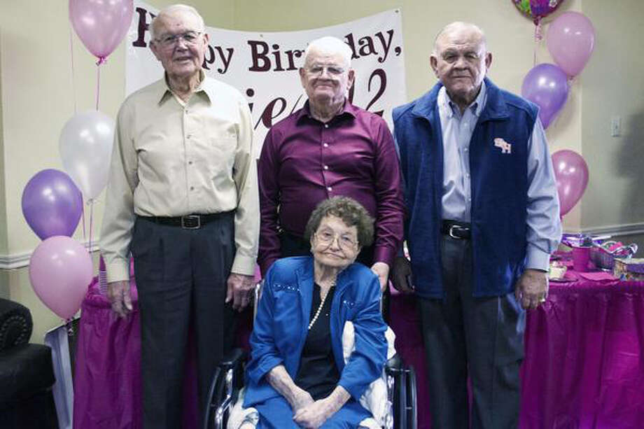 Evie Wooten celebrated her birthday on Jan. 18 with sons Joe, 88, left; Finis, 90; and Jeff, 83, right. At 112, she was Walker County's oldest resident. Photo: Photo Courtesy Of The Huntsville / Photo courtesy of the Huntsville