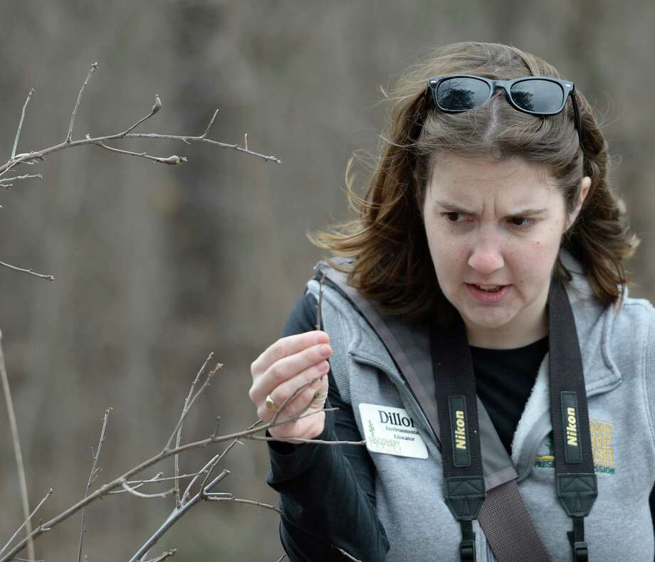 Environmental educator Amanda Dillon identifies butterfly eggs during the Signs of Spring hike April 4, 2014 at the Discovery Center at the Albany Pine Bush Preserve in Albany, N.Y.   (Skip Dickstein / Times Union) Photo: Skip Dickstein / 00026375A