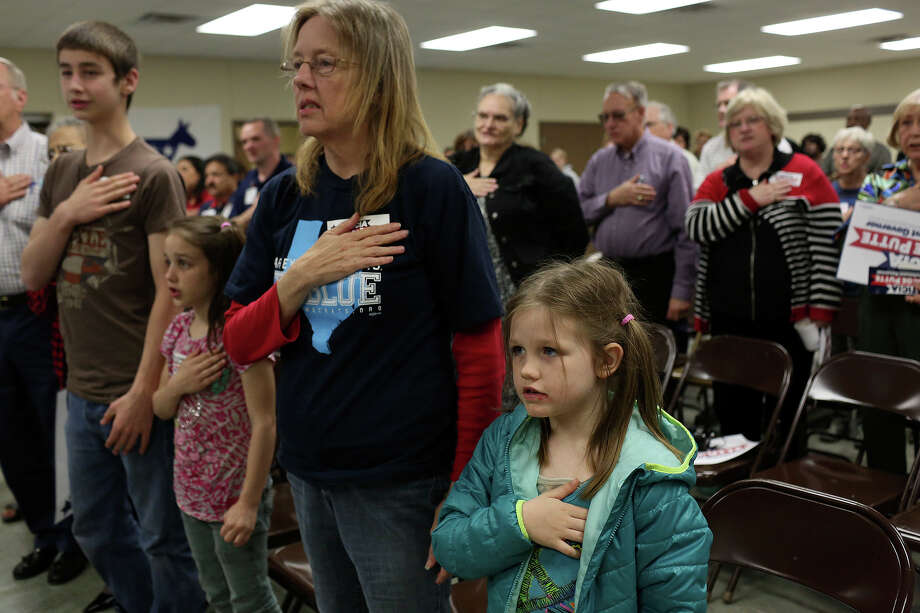 Debra Tullos says the Pledge of Allegiance with her grandchildren, Halstin Beatty, 14, from left, Hope Beatty, 8, and Paige Beatty, 7, at a campaign event for State Senator Leticia Van de Putte at the Labor Temple in Lufkin on Friday, April 4, 2014. Photo: Lisa Krantz, SAN ANTONIO EXPRESS-NEWS / SAN ANTONIO EXPRESS-NEWS