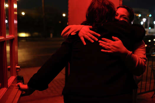 State Senator Leticia Van de Putte embraces supporter Lorraine Montemayor, right, after Van de Putte spotted her wearing a campaign shirt as she sat on the porch upon Van de Putte's arrival for dinner with her staff at pizzaLOUNGE in Dallas after a day filled with campaign events on Thursday, April 3, 2014. Montemayor is originally from San Antonio but now lives in Dallas. Photo: Lisa Krantz, SAN ANTONIO EXPRESS-NEWS / SAN ANTONIO EXPRESS-NEWS