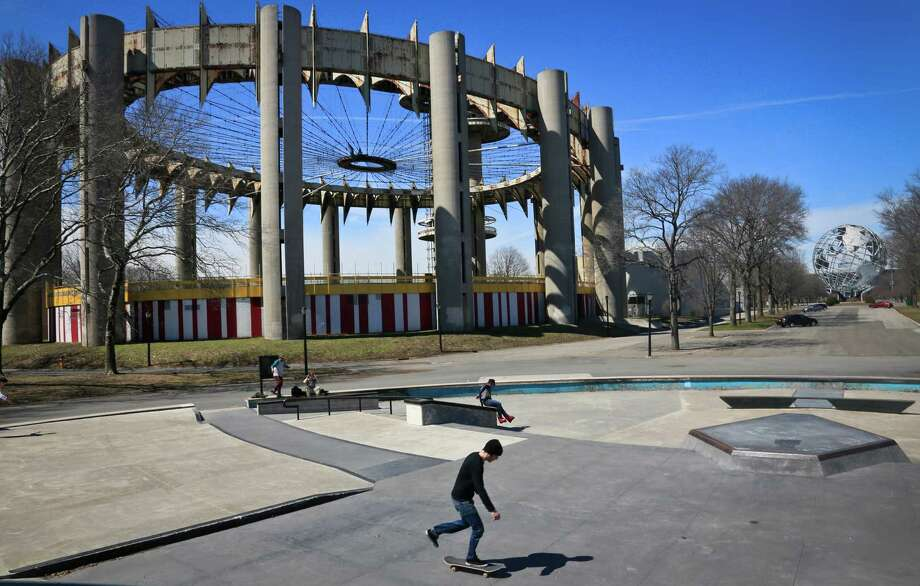 "Space-age towers, topped by flying-saucer-like platforms, and a pavilion of pillars once called the ""Tent of Tomorrow"" and now a playground for skaters, looms as relics remaining from the 1964 World's Fair, on Tuesday April 1, 2014 in the Queens borough of New York.  As this month's 50th anniversary of the 1964 New York World's Fair approaches, a group of preservationists is fighting to save the pavilion, but others see them as annoying eyesores that should be torn down. Neither option would come cheap: an estimated $14 million for demolition and up to $72 million for renovation.  (AP Photo/Bebeto Matthews) ORG XMIT: NYBM306 Photo: Bebeto Matthews / AP"