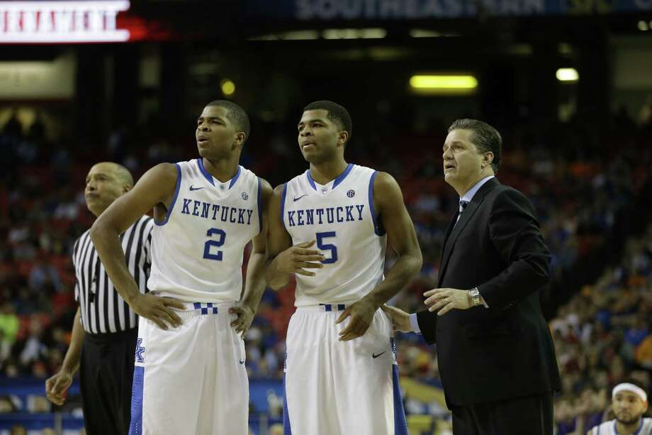 """Kentucky coach John Calipari says Texas is """"not just a football state,"""" as shown by the Texans on his team, including Aaron, left, and Andrew Harrison of Houston. Photo: Steve Helber, STF / AP"""