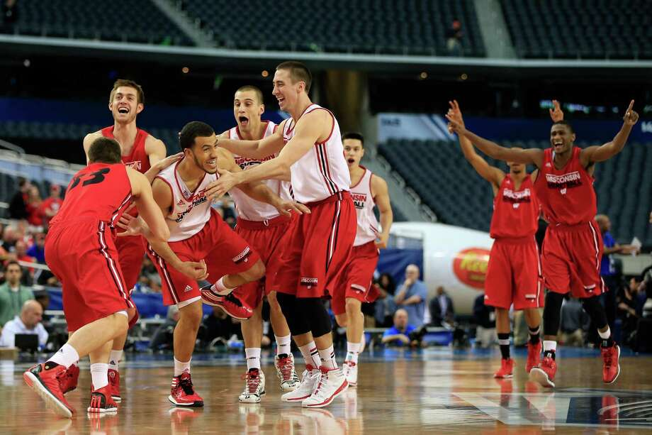 ARLINGTON, TX - APRIL 04:  Traevon Jackson #12 of the Wisconsin Badgers celebrates with his teammates after making a half court shot as the Badgers practice ahead of the 2014 NCAA Men's Final Four at AT&T Stadium on April 4, 2014 in Arlington, Texas.  (Photo by Jamie Squire/Getty Images) ORG XMIT: 461763375 Photo: Jamie Squire / 2014 Getty Images