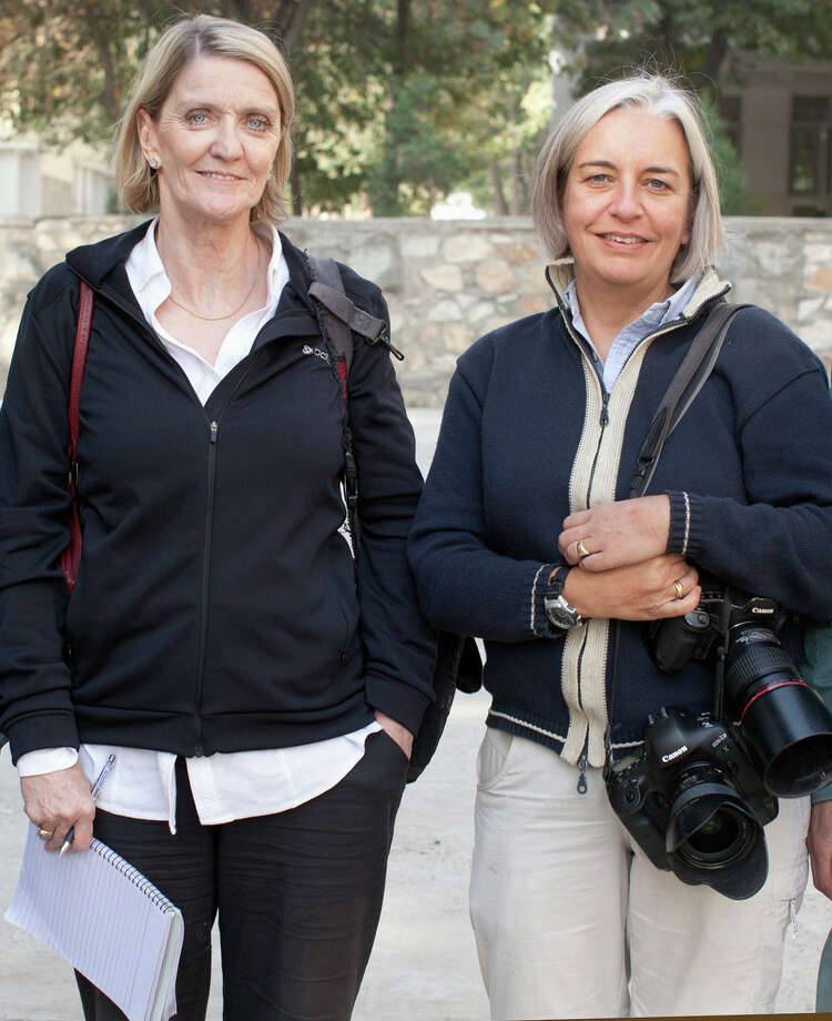 This 2012 photo shows Kathy Gannon, left, Associated Press special correspondent for Afghanistan and Pakistan, and AP photographer Anja Niedringhaus in Afghanistan. An Afghan police commander opened fire Friday, April 4, 2014 on the two journalists inside a security forces base in eastern Afghanistan, killing Niedringhaus and wounding Gannon. (AP Photo) ORG XMIT: NYPS501 / AP