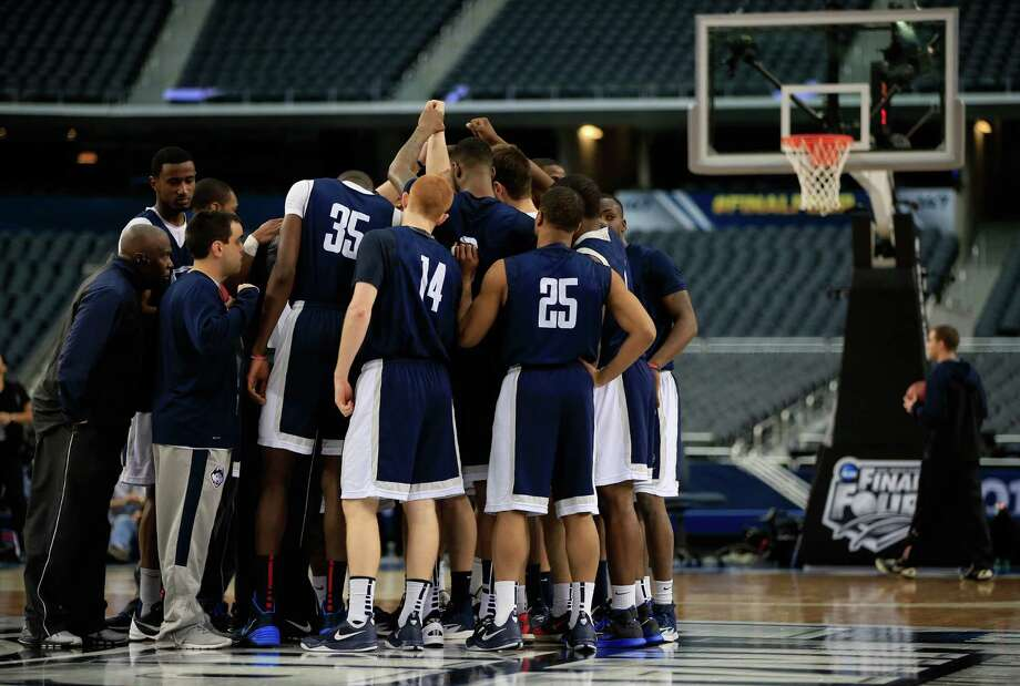 ARLINGTON, TX - APRIL 04:  The Connecticut Huskies huddle as they practice ahead of the 2014 NCAA Men's Final Four at AT&T Stadium on April 4, 2014 in Arlington, Texas.  (Photo by Jamie Squire/Getty Images) ORG XMIT: 461763375 Photo: Jamie Squire / 2014 Getty Images