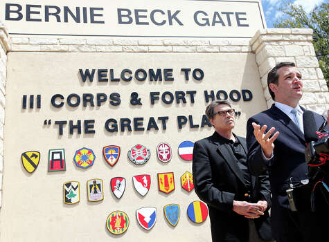 U.S. Sen. Ted Cruz (right) speaks as Gov. Rick Perry and other local officials listen during a press conference held at Fort Hood's main gate Friday April 4, 2014 in Fort Hood, Texas. Iraq war veteran Ivan Lopez opened fire Wednesday afternoon, killing three soldiers and wounding 16 before killing himself as he was confronted by a military policewoman. Photo: Edward A. Ornelas, San Antonio Express-News / ©2014 San Antonio Express-News