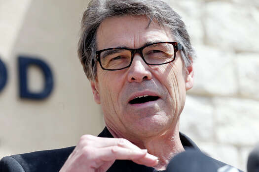 Gov. Rick Perry speaks during a press conference held at Fort Hood's main gate Friday April 4, 2014 in Fort Hood, Texas. Iraq war veteran Ivan Lopez opened fire Wednesday afternoon, killing three soldiers and wounding 16 before killing himself as he was confronted by a military policewoman. Photo: Edward A. Ornelas, San Antonio Express-News / ©2014 San Antonio Express-News
