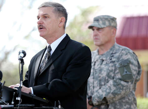 U.S. Army Criminal Investigation Command (CID) spokesman Chris Grey (left) speaks as Lt. Gen. Mark Milley and others listen during a press conference held Friday April 4, 2014 in Fort Hood, Texas on the shooting that occurred Wednesday.  Iraq war veteran Ivan Lopez, who opened fire Wednesday afternoon, killing three soldiers and wounding 16 before killing himself as he was confronted by a military policewoman. Photo: Edward A. Ornelas, San Antonio Express-News / ©2014 San Antonio Express-News