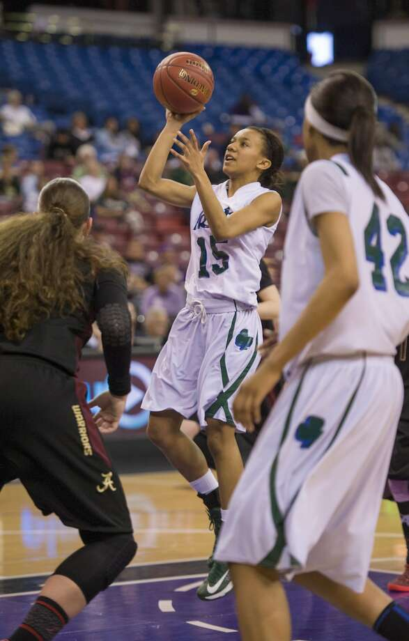 Sacred Heart Cathedral guard  GeAnna Summers-Luaulu led the Irish to a 21-8 season. Photo: Brian Baer, Special To The Chronicle