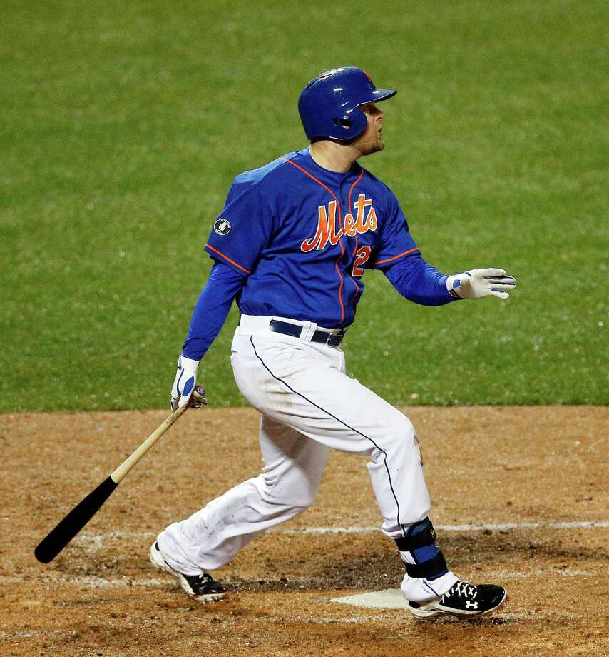 New York Mets' Lucas Duda watches his two-run home run in the fourth inning of a baseball game against the Cincinnati Reds at Citi Field in New York, Friday, April 4, 2014. (AP Photo/Paul J. Bereswill)  ORG XMIT: NYM112 Photo: Paul Bereswill / FR168017 AP