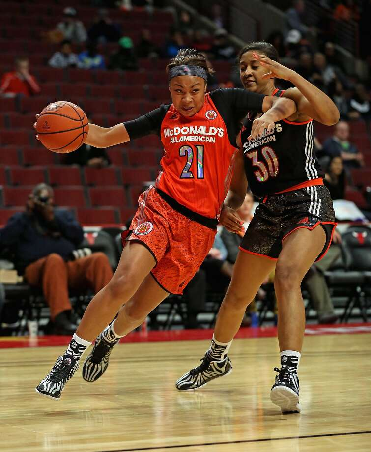 Mariya Moore (left) drives to the basket during last week's McDonald's All-American game in Chicago. Moore will ride her high school success to the University of Louisville next year. Photo: Jonathan Daniel, Getty Images