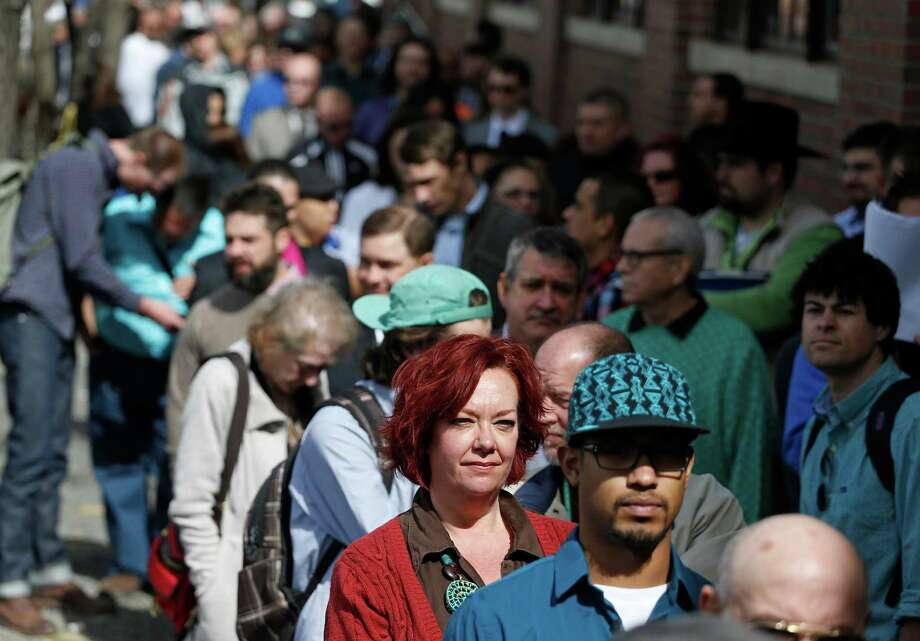 Job seekers line up to attend a marijuana industry job fair in Denver last month. The government reported Friday that employers added 192,000 jobs in March. Photo: Brennan Linsley, STF / AP