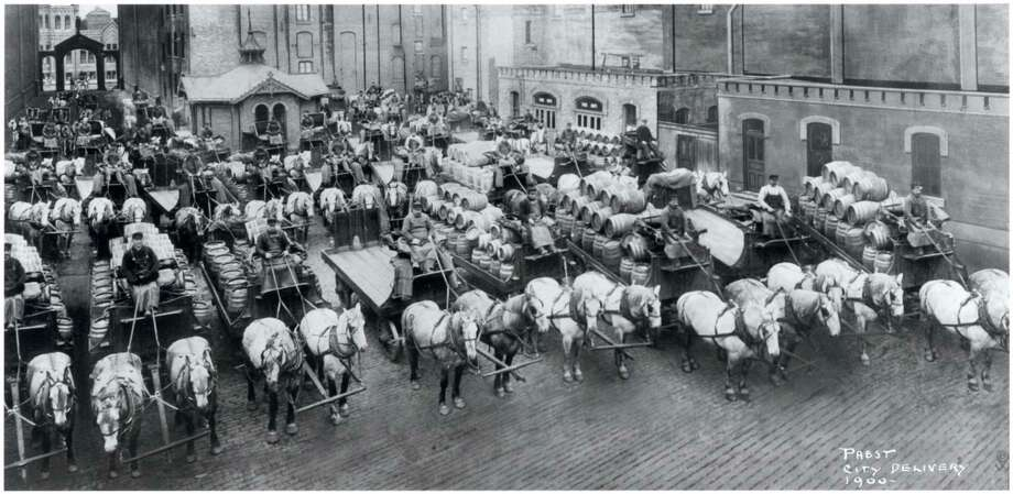 Beer wagons and horse teams lined up to carry one day's delivery of beer for Milwaukee establishments in 1900. A small group in Milwaukee wants to revive the city's beer brewing tradition by buying Pabst Brewing Co. Photo: Carrie Antlfinger, HOEP / Pabst Mansion
