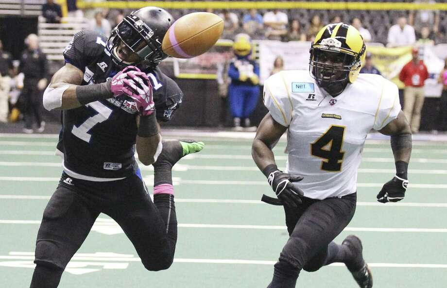 D. J. Stephens (left) mishandles a pass as Pittsburgh's Virgil Gray covers Friday at the Alamodome. The 0-4 Talons lost their second straight by 40-plus points. Photo: Kin Man Hui / San Antonio Express-News / ©2014 San Antonio Express-News