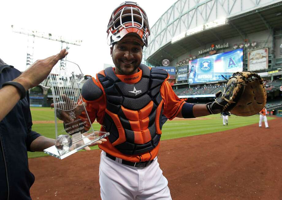 Astros catcher Carlos Corporan hams it up after he received the Darryl Kile Award on Friday. The award honors the player who exemplifies Kile's trait of being a good teammate. Photo: Karen Warren, Staff / © 2014 Houston Chronicle