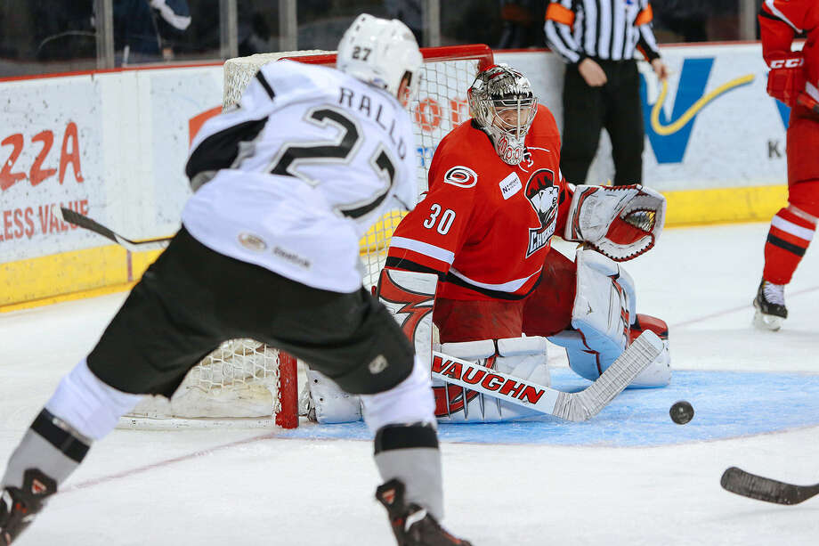 The Rampage's Greg Rallo takes a shot on Charlotte goalie John Muse during the second period of San Antonio's victory at the AT&T Center. Photo: Josh Huskin / For The Express-News / www.joshhuskin.com
