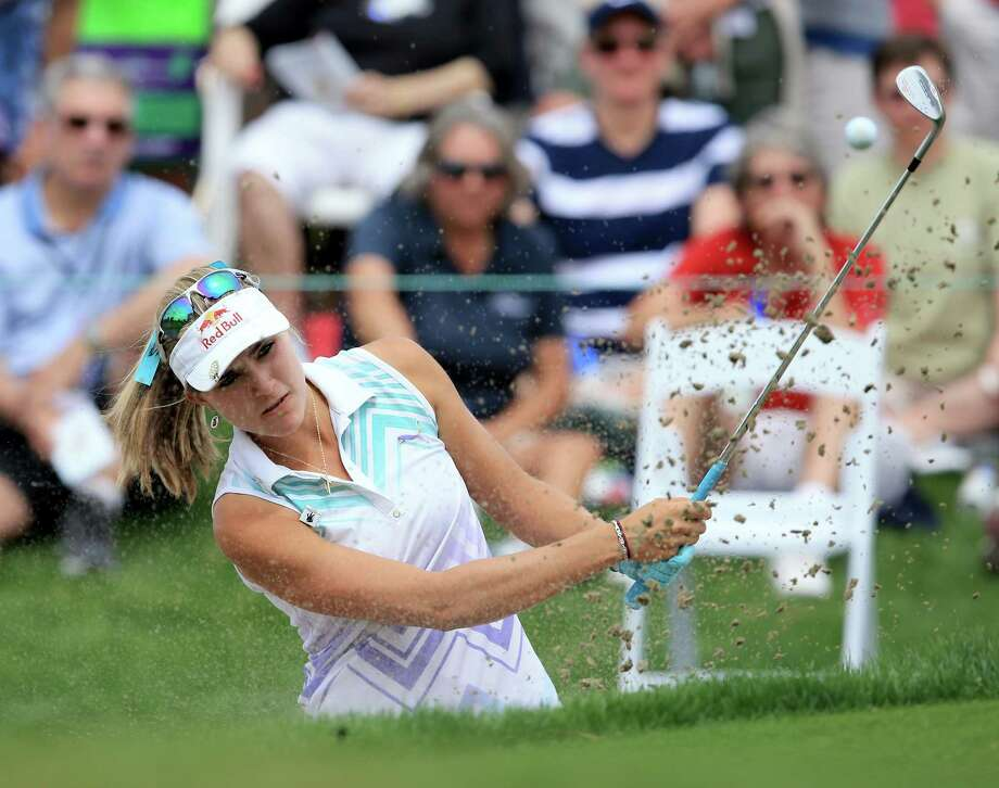Lexi Thompson was right at home on, or just off, the green Friday, firing an 8-under 64 to grab a share of the lead at the Kraft Nabisco Championship. Photo: David Cannon, Staff / 2014 Getty Images
