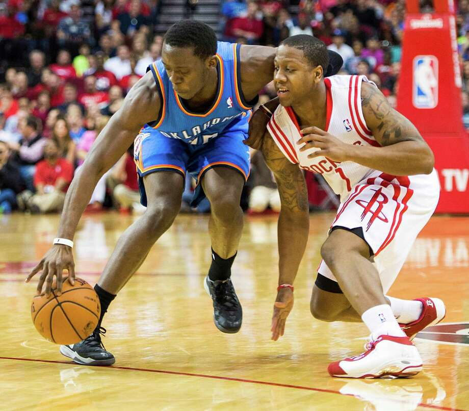 Oklahoma City Thunder guard Reggie Jackson (15) steals the ball from Rockets guard Isaiah Canaan (1). Focus on the basics has helped set the Thunder apart. Photo: Smiley N. Pool, Staff / © 2014  Houston Chronicle
