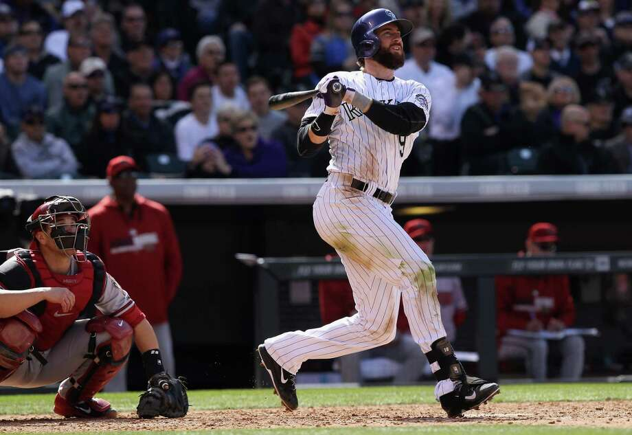 Charlie Blackmon had a banner day, going 6-for-6 in the Rockies' win. Photo: Doug Pensinger, Staff / 2014 Getty Images