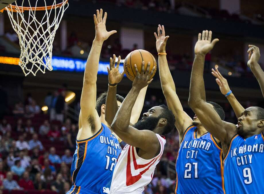 April 4: Rockets 111, Thunder 107Rockets guard James Harden puts up a shot as Thunder center Steven Adams, guard Andre Roberson and forward Serge Ibaka defend. Photo: Smiley N. Pool, Houston Chronicle
