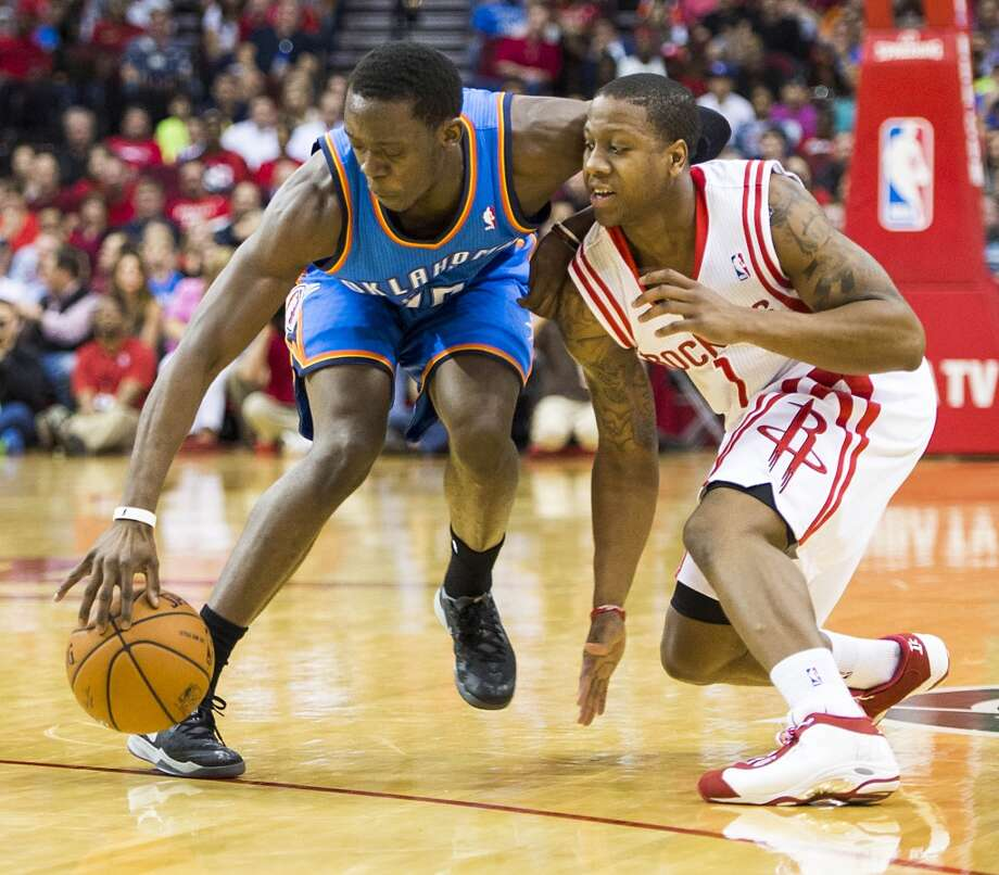 Thunder guard Reggie Jackson steals the ball from Rockets guard Isaiah Canaan. Photo: Smiley N. Pool, Houston Chronicle