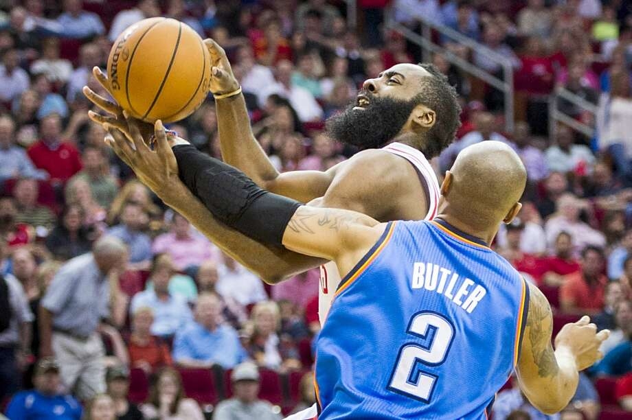 Rockets guard James Harden is fouled by Thunder forward Caron Butler. Photo: Smiley N. Pool, Houston Chronicle
