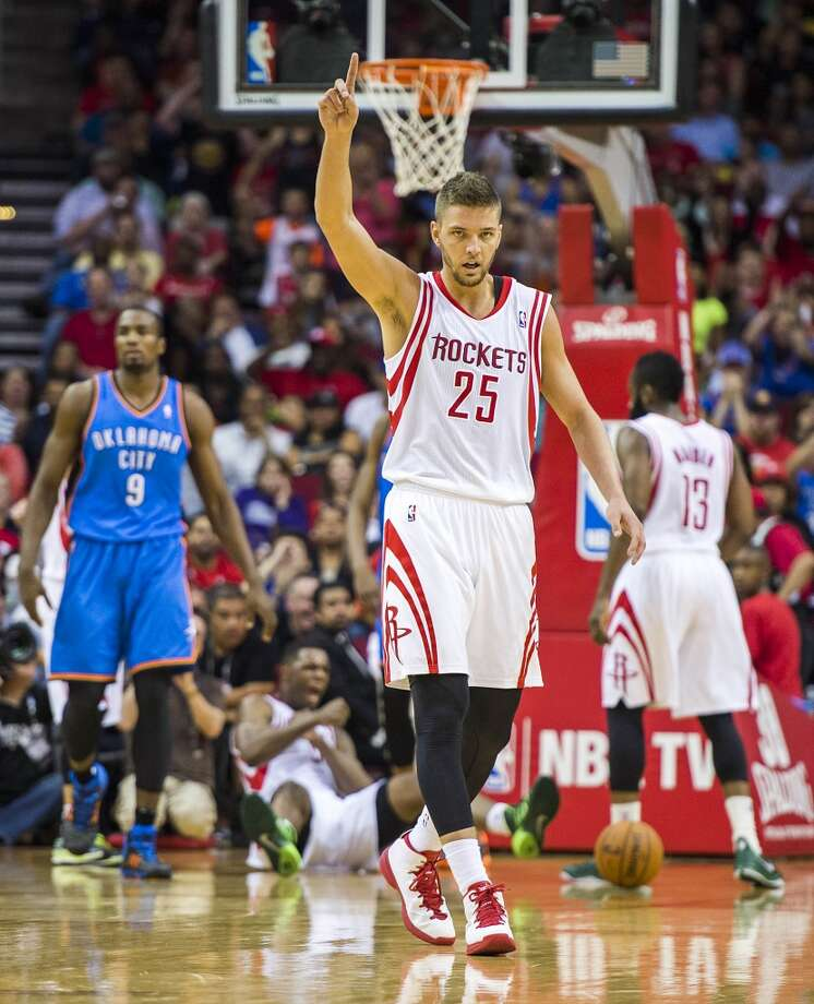 Rockets forward Chandler Parsons celebrates after a call went against the Thunder. Photo: Smiley N. Pool, Houston Chronicle
