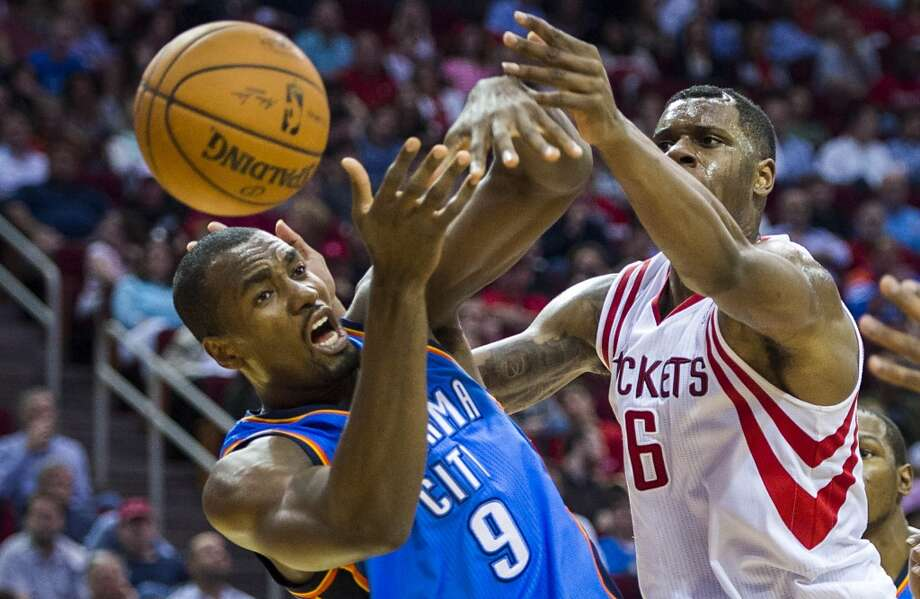 Thunder forward Serge Ibaka fights for a rebound against Rockets forward Terrence Jones. Photo: Smiley N. Pool, Houston Chronicle