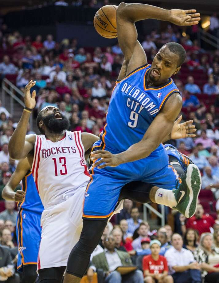 Rockets guard James Harden gets tangled with Thunder forward Serge Ibaka. Photo: Smiley N. Pool, Houston Chronicle
