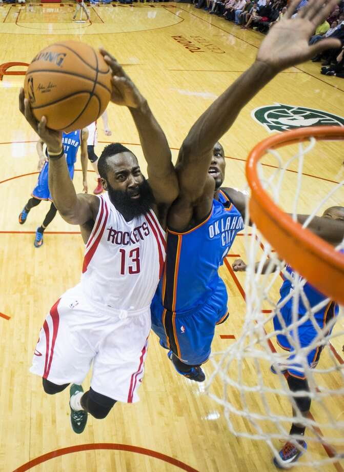 Rockets guard James Harden drives to the basket against Thunder forward Serge Ibaka. Photo: Smiley N. Pool, Houston Chronicle