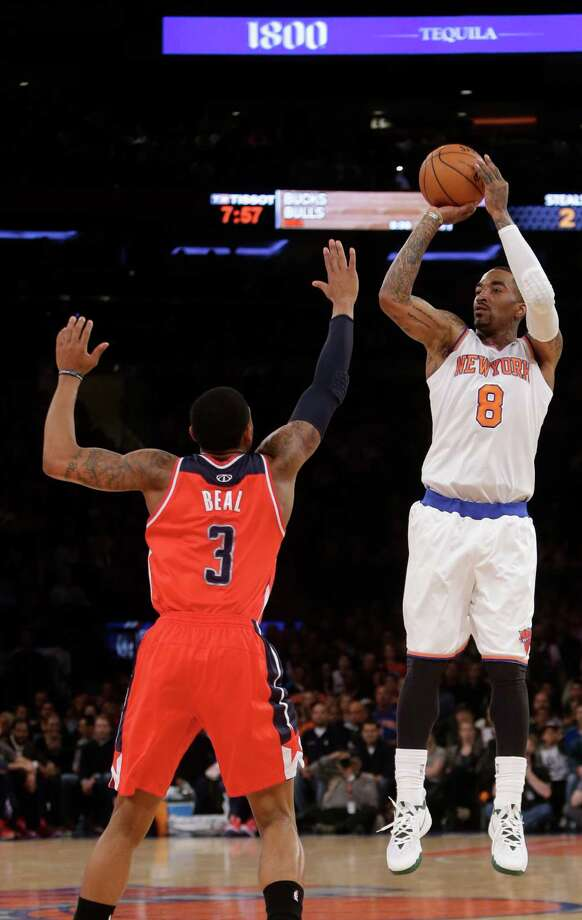 New York Knicks' J.R. Smith (8) shoots over Washington Wizards' John Wall (2) during the first half of an NBA basketball game Friday, April 4, 2014, in New York. (AP Photo/Frank Franklin II) ORG XMIT: MSG104 Photo: Frank Franklin II / AP