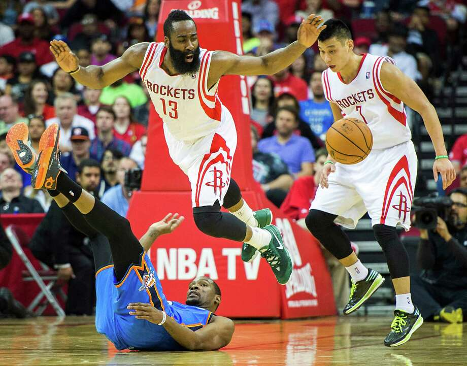 Guard James Harden (13) helped the Rockets jump past the Thunder and their star, Kevin Durant, scoring 39 points and pairing with Jeremy Lin, right, to lift the Rockets into the playoffs Friday night at Toyota Center. Photo: Smiley N. Pool, Staff / © 2014  Houston Chronicle