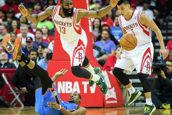 Guard James Harden (13) helped the Rockets jump past the Thunder and their star, Kevin Durant, scoring 39 points and pairing with Jeremy Lin, right, to lift the Rockets into the playoffs Friday night at Toyota Center.