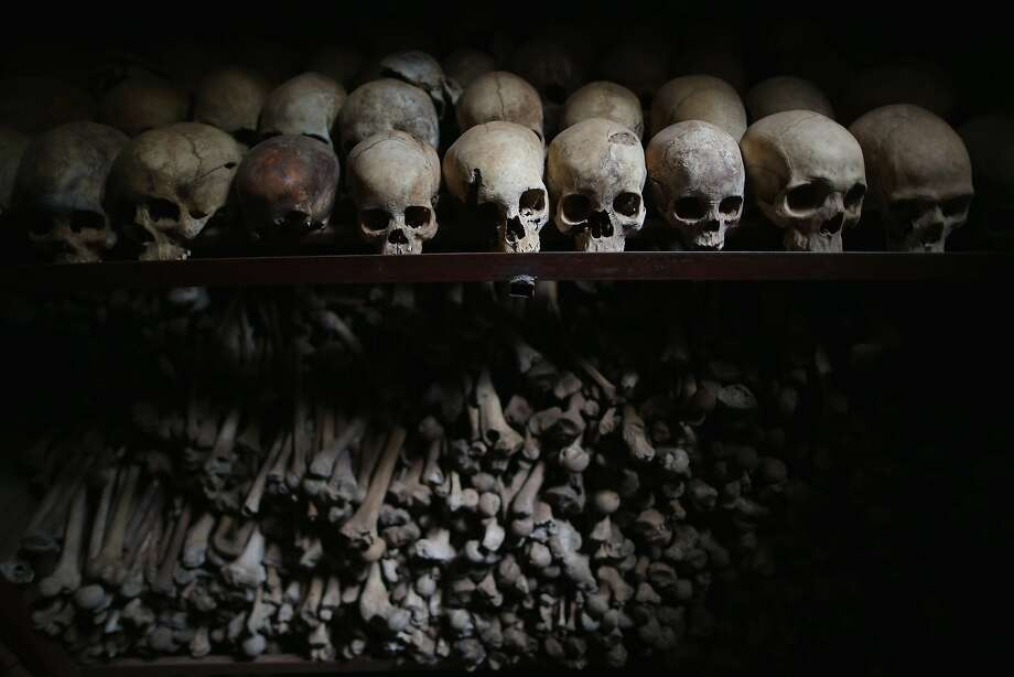 Twentieth anniversary of Rwanda atrocities:Metal racks hold the bones of thousands of genocide victims inside one of the crypts at the Nyamata Catholic Church memorial in Nyamata, Rwanda. On April 13, 1994, attackers used guns 