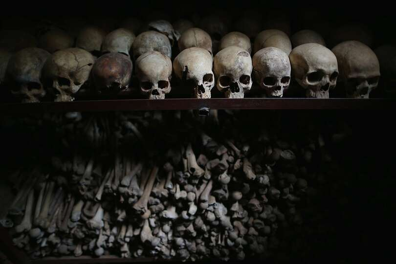 NYAMATA, RWANDA - APRIL 04:  Metal racks hold the bones of thousands of  genocide victims inside one