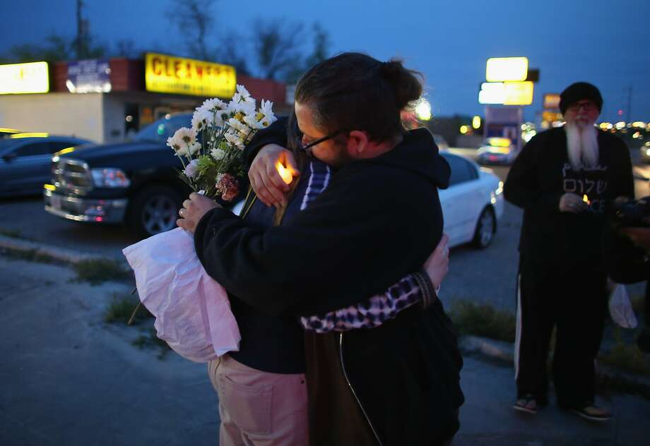 KILLEEN, TX - APRIL 04:  Malachi Muncy (R) hugs Laura Muncy as they gather together during a vigil to remember those killed and injured by Iraq war veteran Ivan Lopez on April 4, 2014 in Killeen, Texas. Lopez killed three and wounded 16 before taking his own life on the Fort Hood Army base.  (Photo by Joe Raedle/Getty Images) Photo: Joe Raedle, Getty Images