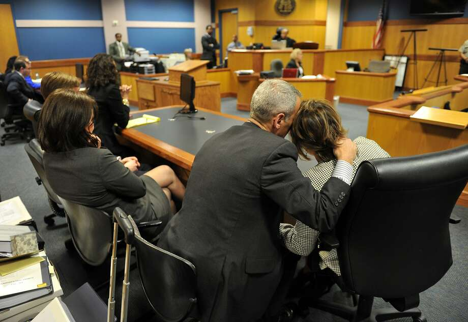 Stacey Kalberman, right, and her husband Neil embrace after winning a whistle blower lawsuit against the state ethics commission, Friday, April 4, 2014, in Atlanta. The former state ethics commission executive director sued after she claimed she was  forced from her position after investigating Gov. Nathan Deal's campaign. (AP Photo/Atlanta Journal-Constitution, Brant Sanderlin) Photo: Brant Sanderlin, Associated Press