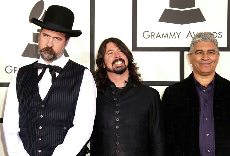 From left to right, Krist Novoselic, Dave Grohl and Pat Smear pose at the Grammy awards on Jan. 26, 2014 in Los Angeles. Smear toured with Nirvana in its last year and is now with the Foo Fighters with Grohl.  Photo: Jeff Vespa/WireImage, Getty Images / WireImage