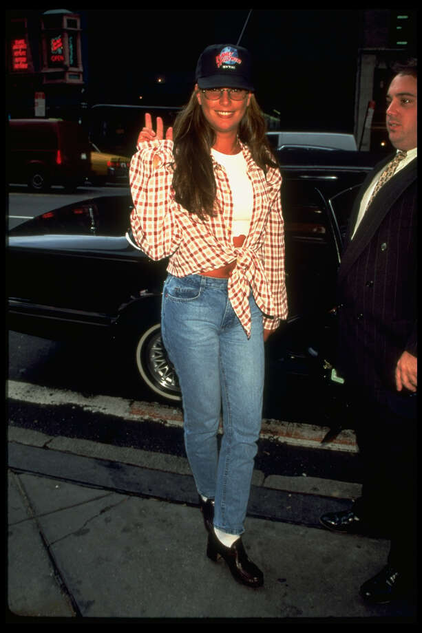 The grunge uniform made its way to MTV veejay Daisy Fuentes in in the '90s at Planet Hollywood.  Photo: Time Life Pictures, Getty Images / Time & Life Pictures