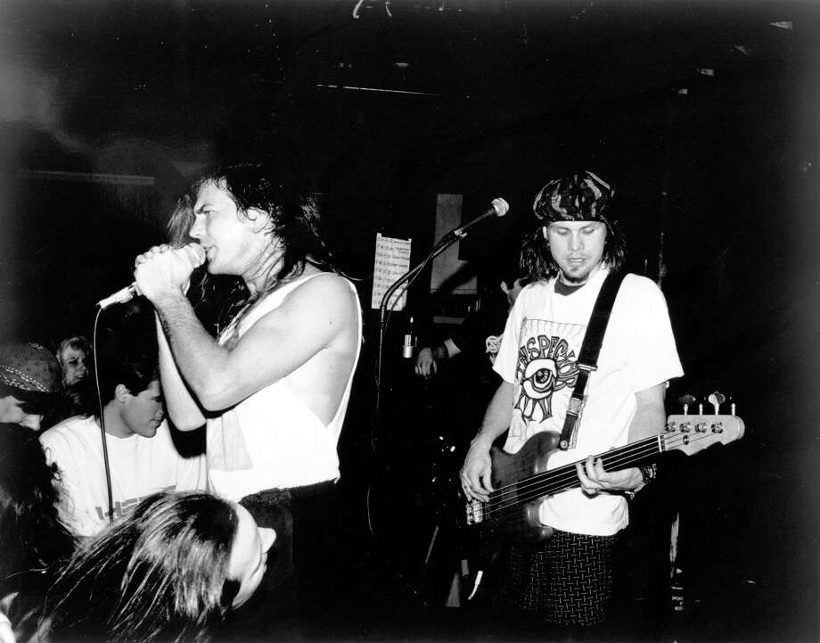 Eddie Vedder, left, and Jeff Ament of Pearl Jam play at the Off Ramp, a long-gone dive bar and punk club in Seattle, on Feb. 26, 1991. Photo: Alison Braun/Michael Ochs Archives, Getty Images / Michael Ochs Archives