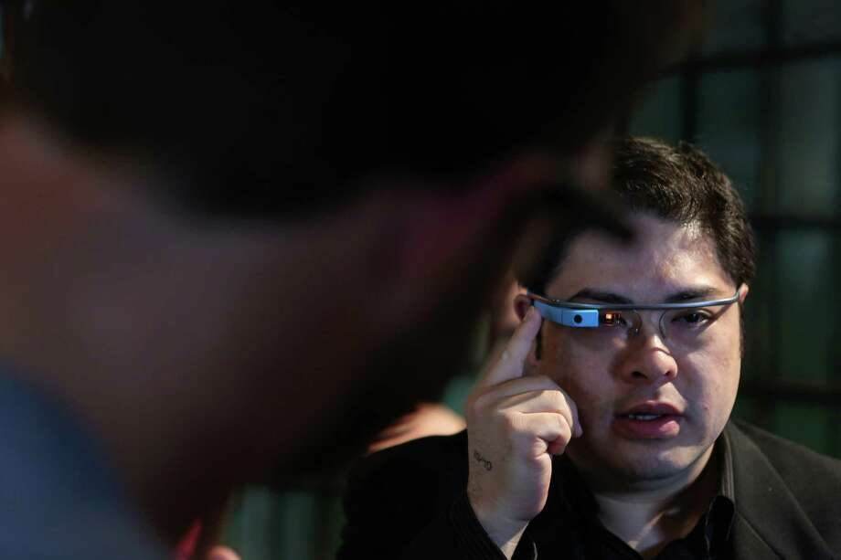 David Cho tries Google Glass during a public preview on Friday, April 4, 2014. The Google device will be available for the public to try on April 5th and 6th. Photo: JOSHUA TRUJILLO, SEATTLEPI.COM / SEATTLEPI.COM