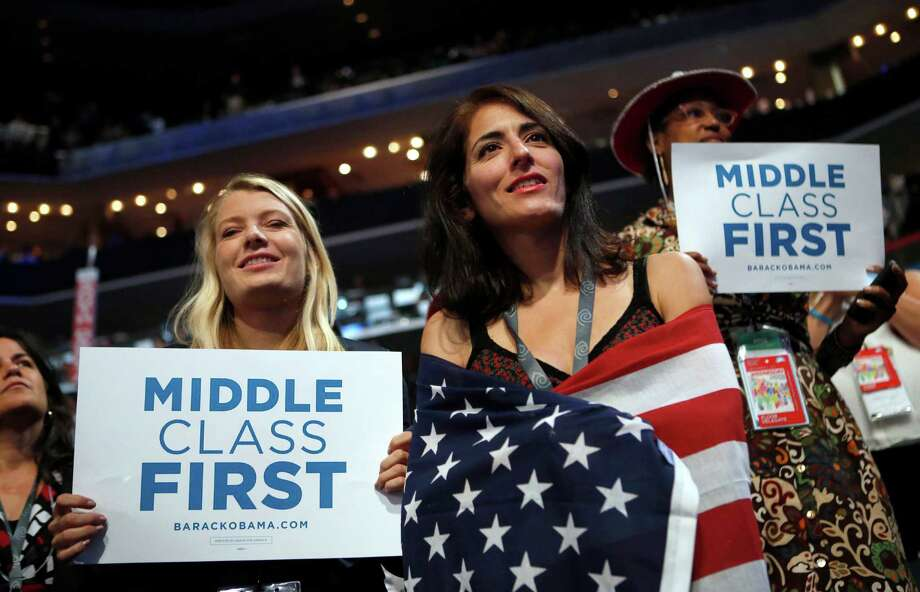 Delegates watch as former President Bill Clinton addresses the Democratic National Convention in Charlotte, N.C., in 2012. Since 2008, the number of people who call themselves middle class has fallen by a fifth. Photo: Jae C. Hong, STF / AP