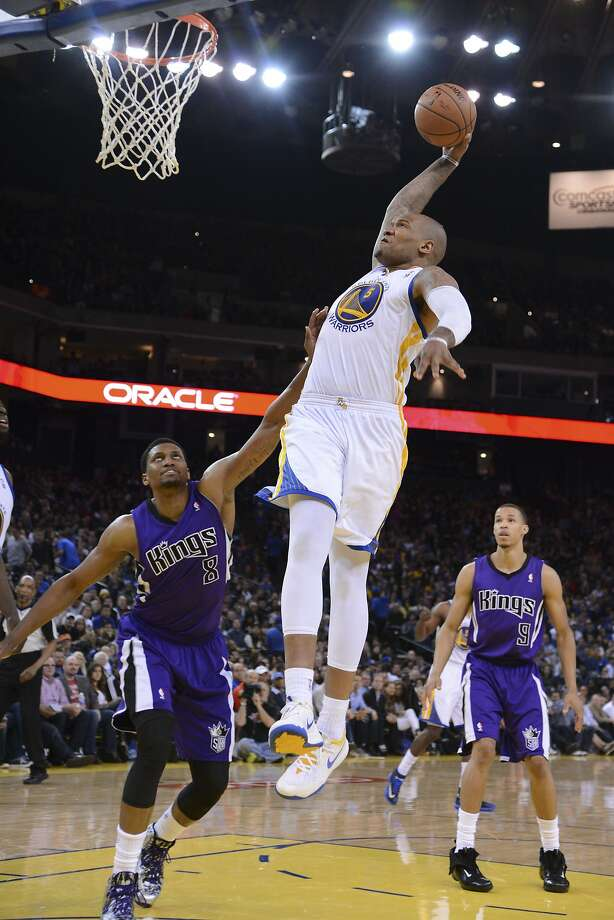 April 4, 2014; Oakland, CA, USA; Golden State Warriors forward Marreese Speights (5) dunks the ball against Sacramento Kings forward Rudy Gay (8) during the third quarter at Oracle Arena. The Warriors defeated the Kings 102-69. Mandatory Credit: Kyle Terada-USA TODAY Sports Photo: Kyle Terada, Reuters