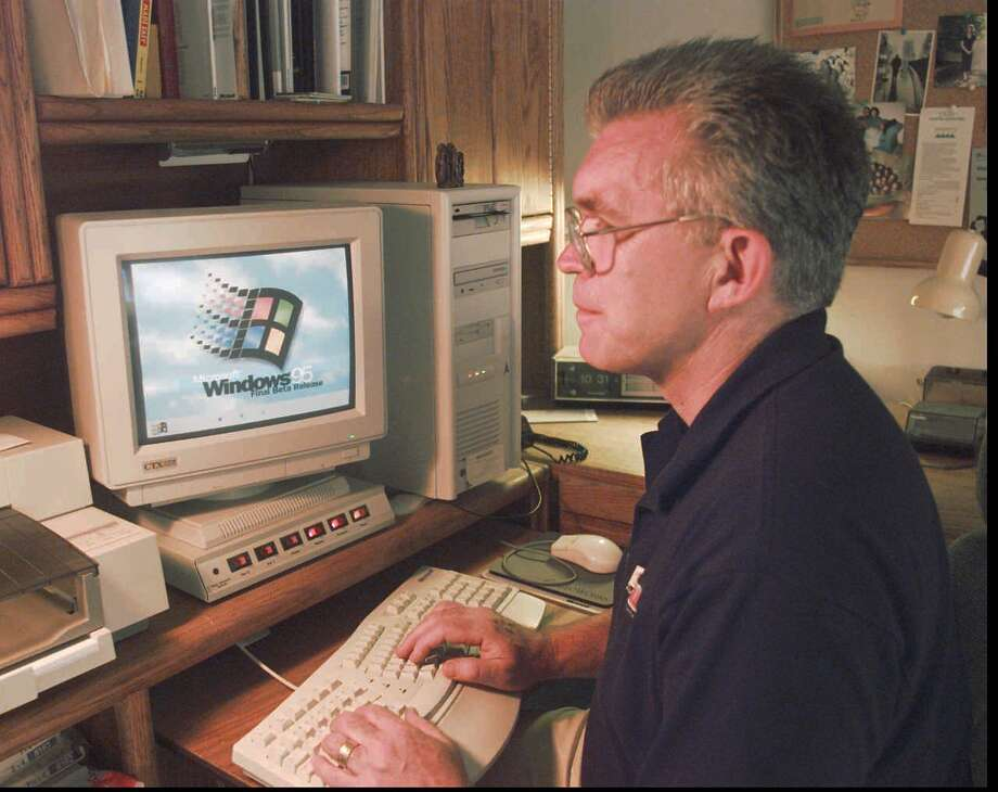 In the '90s, Microsoft continued its march to empire status, evil or otherwise, with the huge release of Windows 95.  Photo: BARRY SWEET, P-I File / AP
