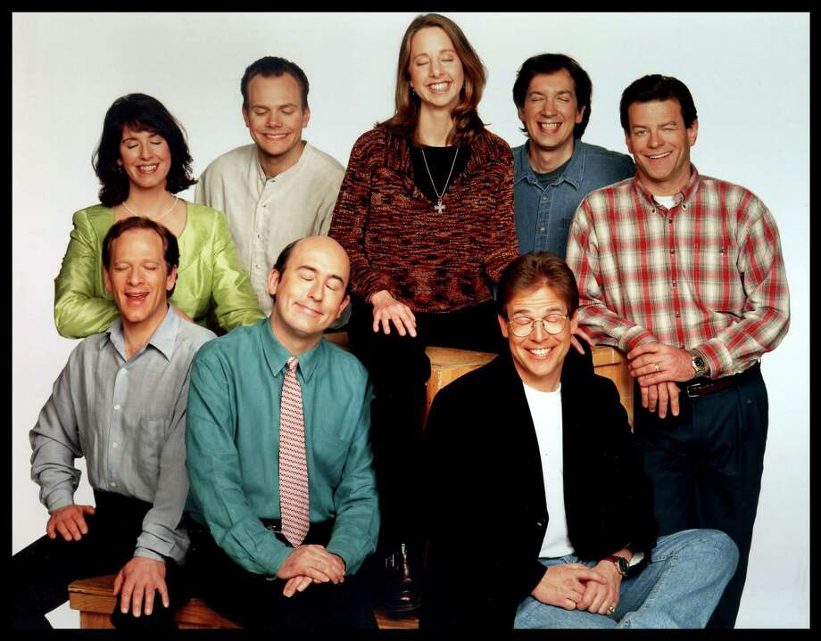 "More hallmarks of Seattle in the '90s: ""Almost Live"" on KING-5. Back row L to R:  Tracey Conway, Joel McHale, Nancy Guppy, Bob Nelson, Pat Cashman. Front row L to R:  Bill Stainton, John Keister, Steve Wilson.  Photo: KING TV HANDOUT, P-I File"